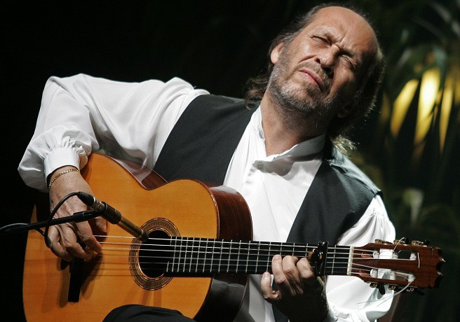 "Spanish guitarist Paco de Lucia performs on stage during a concert as a part of his ""Cositas buenas"" tour in Palma de Mallorca in this January 11, 2008 file photo. Flamenco guitarist de Lucia - one of Spain's most influential musicians and a composer who fused traditional flamenco with jazz and other genres - died on February 26, 2014 of a heart attack in Mexico. A spokesman for the city hall in Algeciras, where de Lucia was born, confirmed his death and said the city would decree two days of official mourning.  REUTERS/Dani Cardona/Files  (SPAIN - Tags: ENTERTAINMENT PROFILE OBITUARY)"